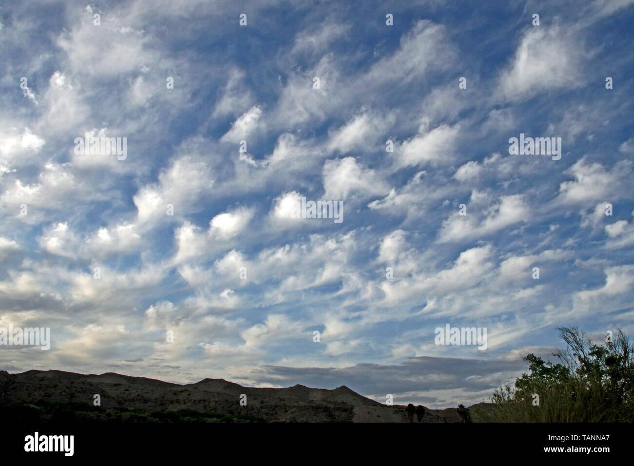 Whispy Cloud Sky - Stock Image