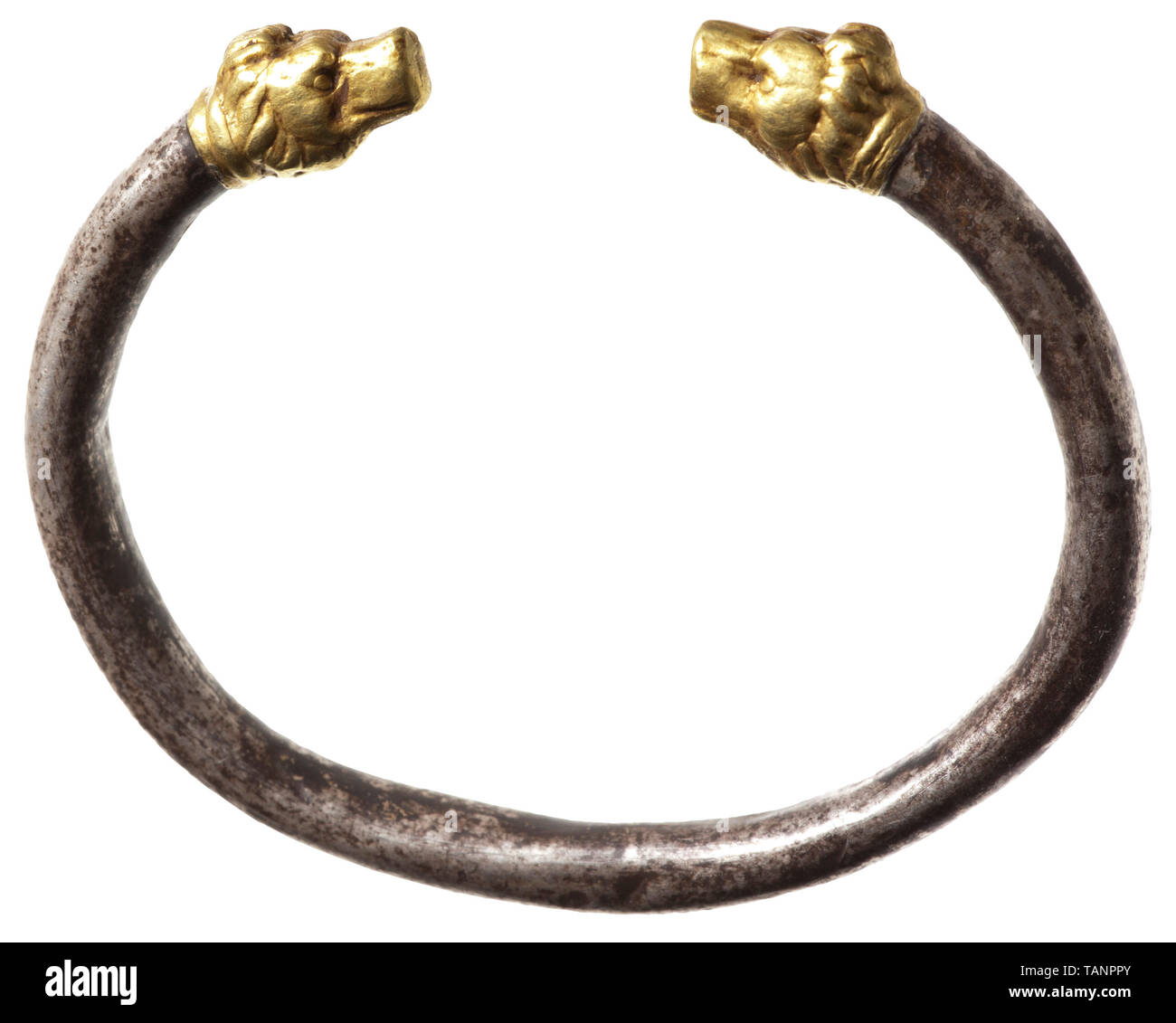 A Hellenistic lion's head bracelet, 3rd century BC, Bangle bracelet of circular section, made of thick sheet silver. Soldered to the ends are gold lion heads made of robust pressed sheet. The hollow metal parts probably stabilised internally with filling material. Weight 20.59 g. Diameter of the silver bangle 5 mm. Maximum width of the bracelet 6.8 cm. Provenance: Austrian private collection, purchased from an art dealer in Vienna in the 1980s. ancient world, ancient times, Greek, Hellas, historic, historical ancient world, Additional-Rights-Clearance-Info-Not-Available - Stock Image