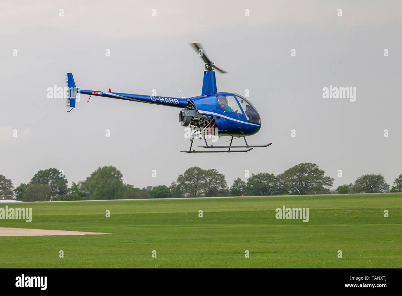Helicopter Flying Low Stock Photos & Helicopter Flying Low