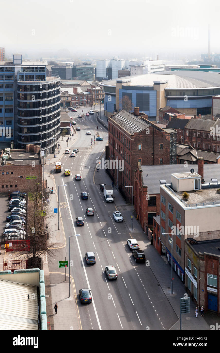 Polluted air. City street and traffic in sunshine but with a hazy sky from air pollution, Nottingham, England, UK - Stock Image