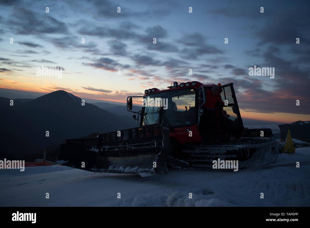 snowmobile at dusk,Prata Mountain,Sibillini National Park,Marche,Italy - Stock Image