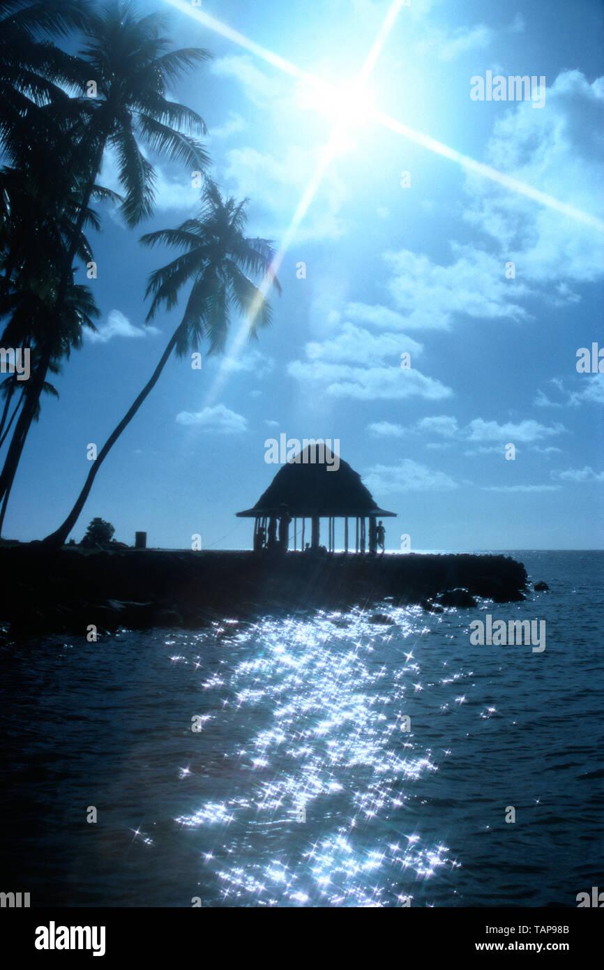 Samoa. Upolu Island. Tropical coast scene with traditional fale beach hut. - Stock Image