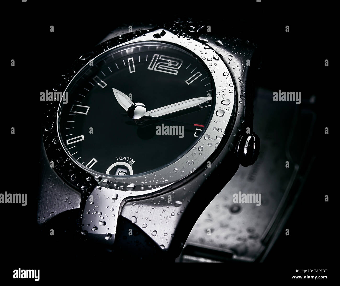 Elegant watch with water drops - Stock Image