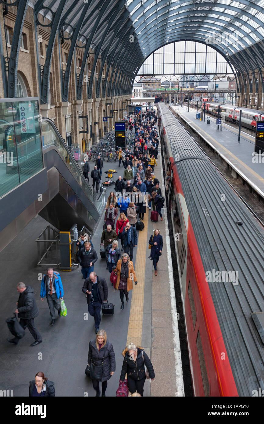 Passengers leaving a LNER, London North eastern railway train at London Kings Cross - Stock Image