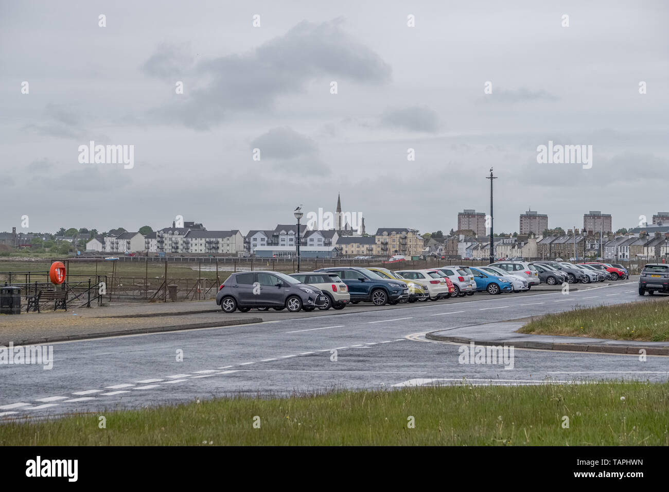 Irvine, Scotland, UK - May 25, 2019: Irvine Harbour North Ayrshire Scotland looking into the town centre with its high flats and church spier Stock Photo