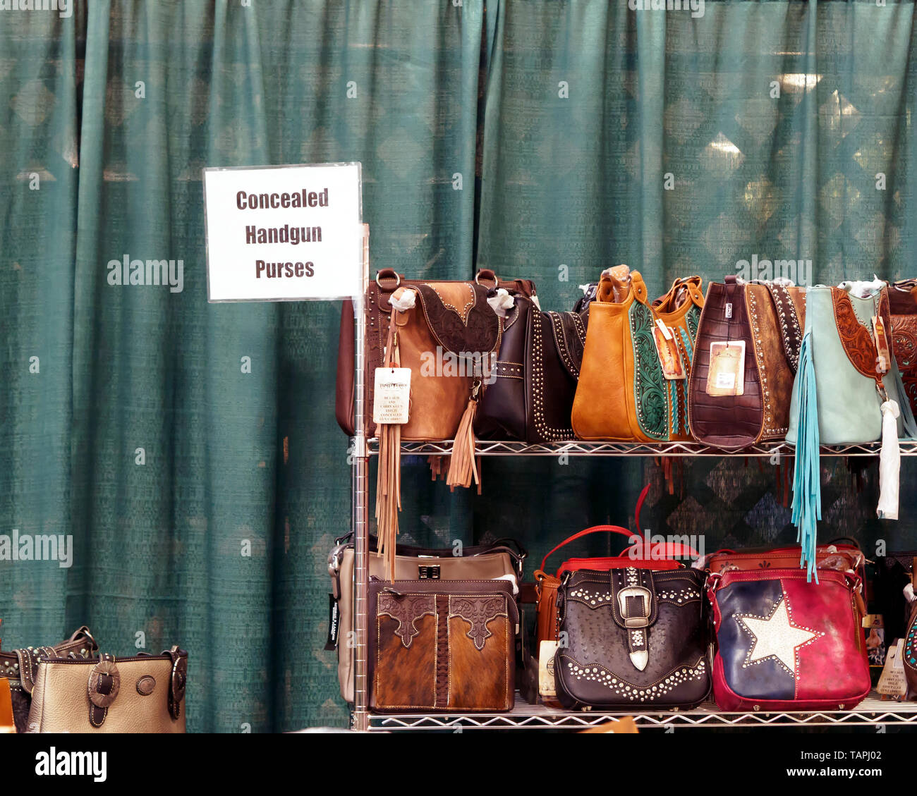 Concealed handgun purses for sale at the Country Peddler Show. Richard M. Borchard Regional Fairgrounds Robstown, Texas USA. Stock Photo