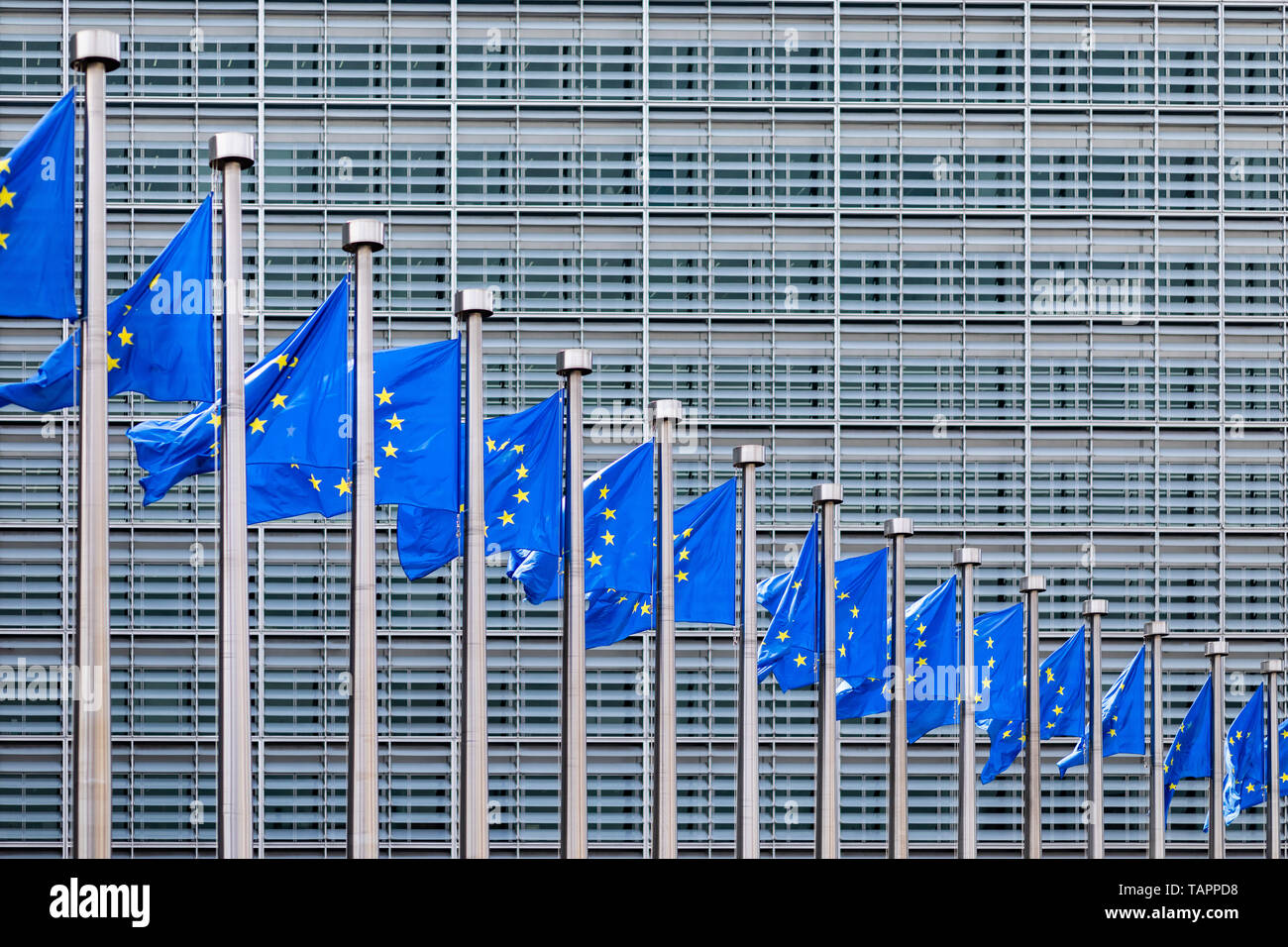 26 May 2019, Belgium, Brüssel: European flags flutter in the wind in front of the Berlaymont building, the seat of the European Commission. From 23 May to 26 May, the citizens of 28 EU states will elect a new parliament. Photo: Marcel Kusch/dpa Stock Photo