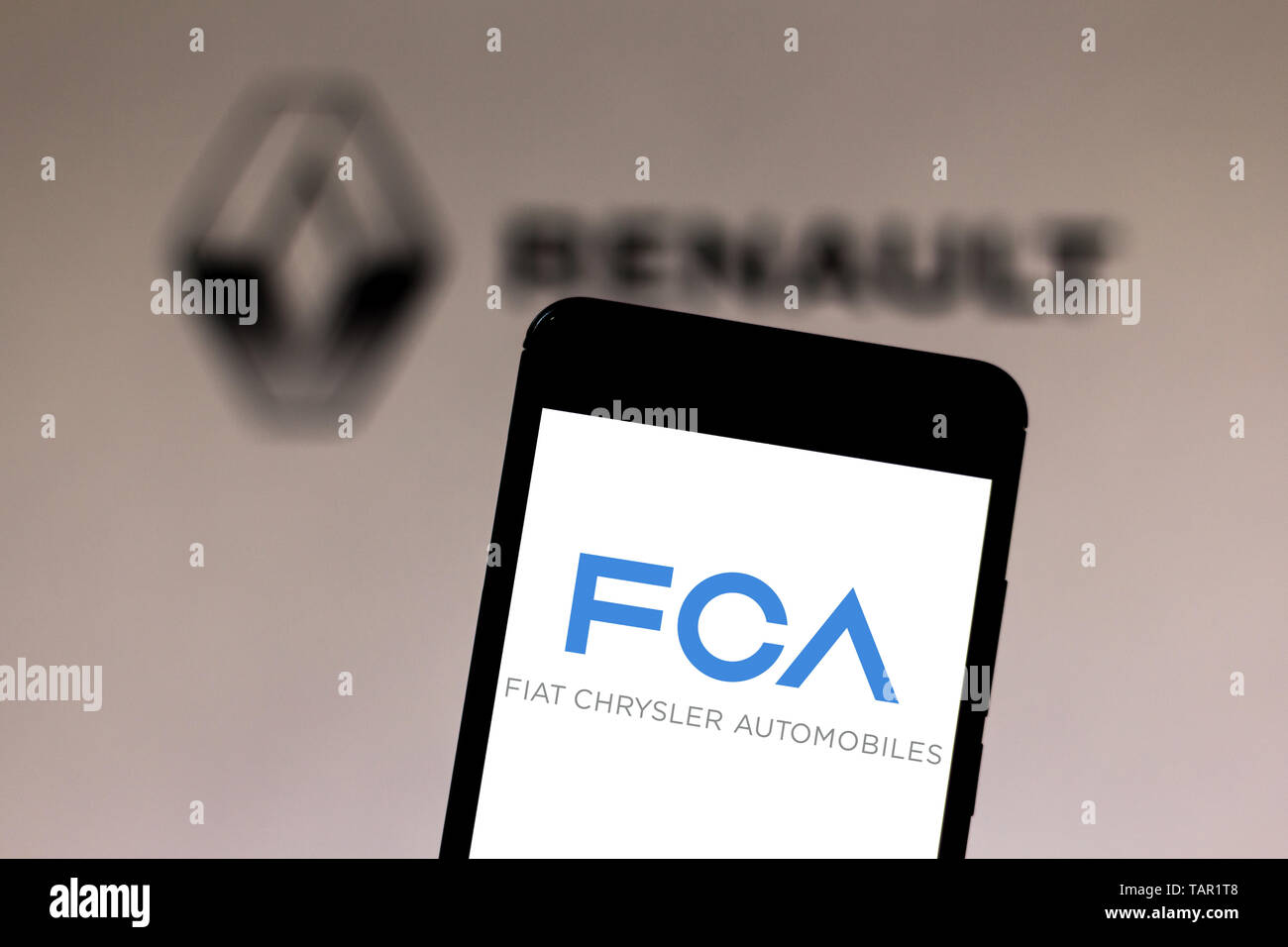Brazil. 27th May, 2019. In this photo illustration the Fiat Chrysler Automobiles logo is seen displayed on a smartphone. Credit: Rafael Henrique/SOPA Images/ZUMA Wire/Alamy Live News Stock Photo