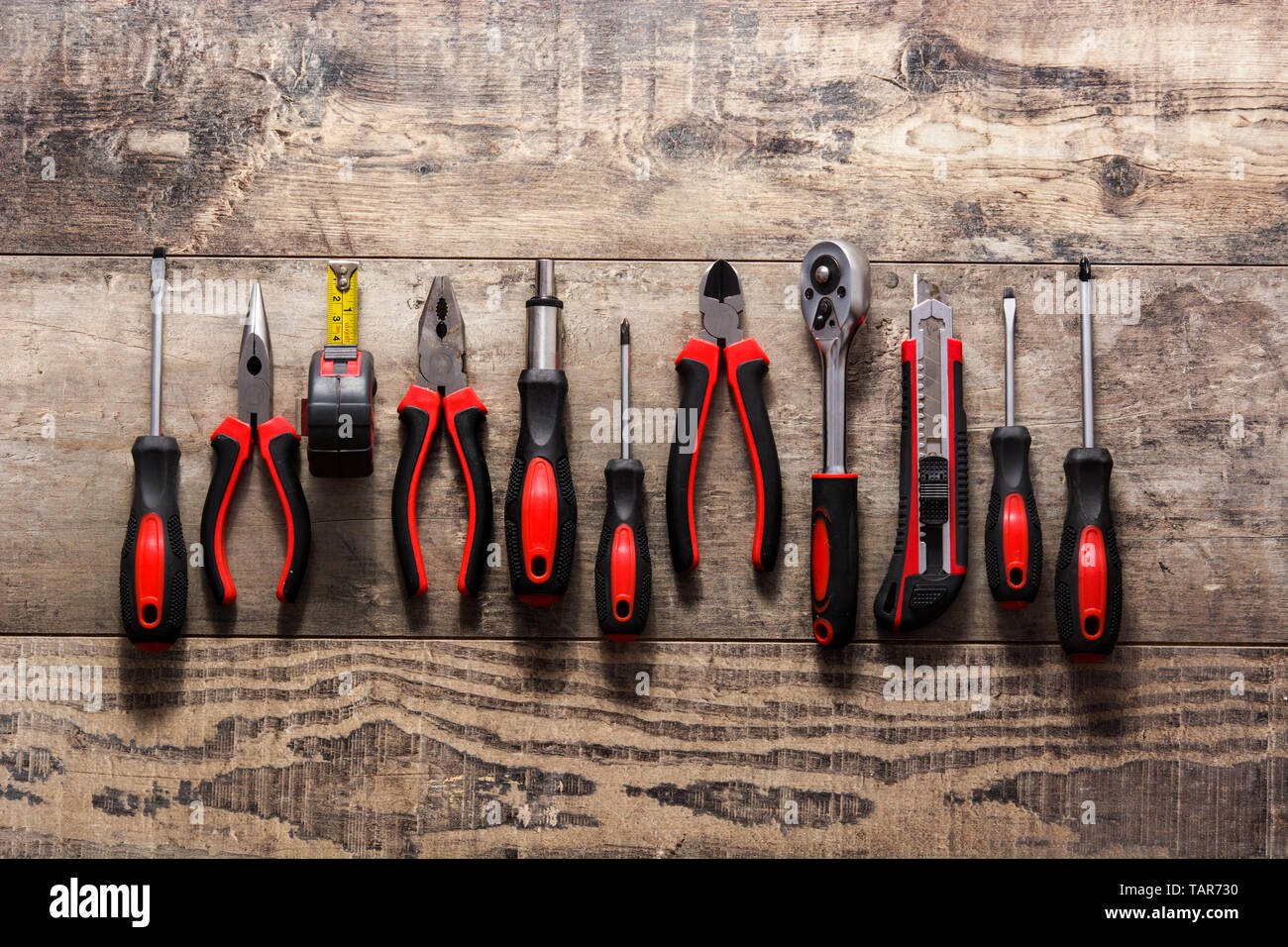 Building tools repair set on wooden table. - Stock Image