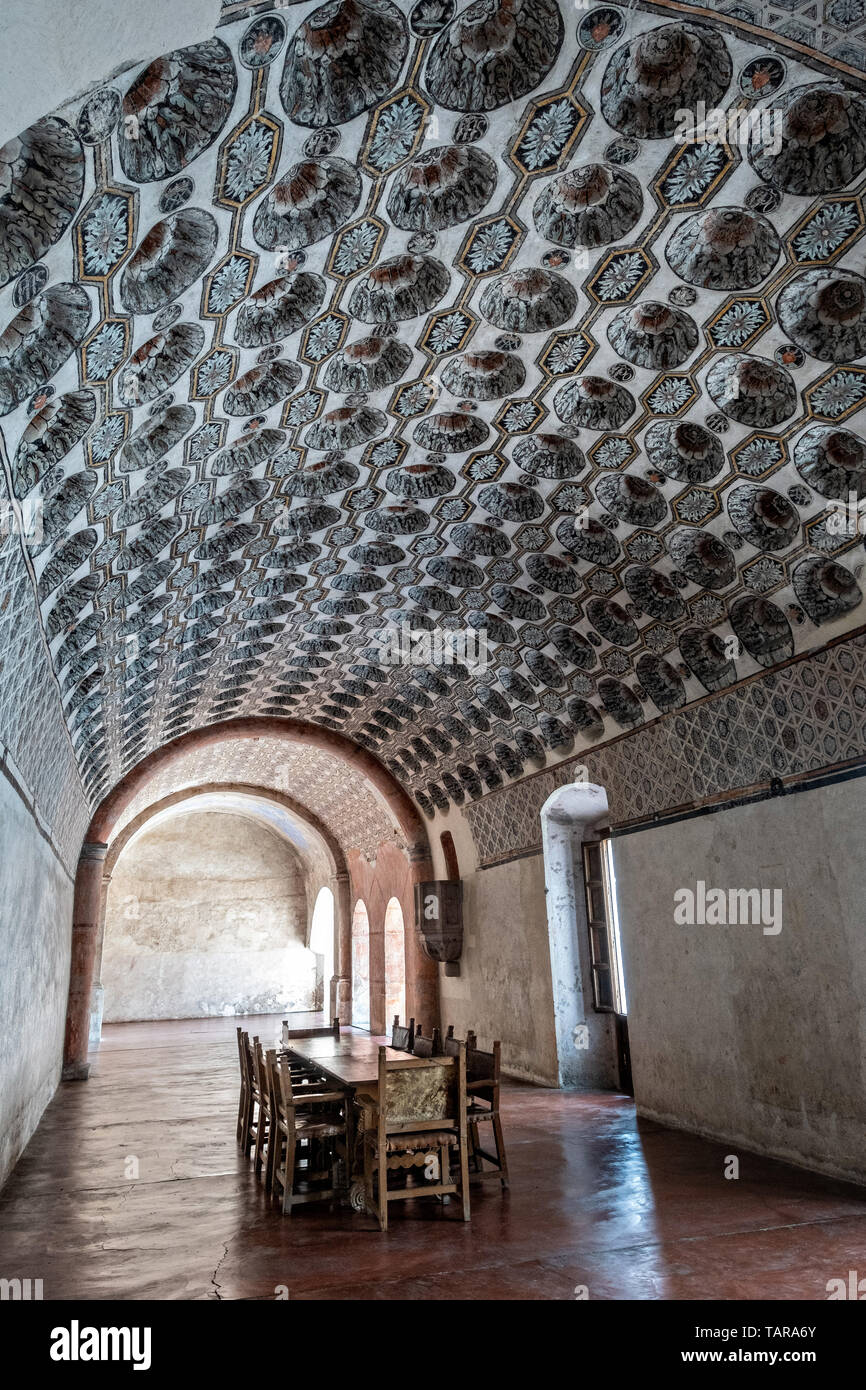 Friars dining room in the San Nicolas Tolentino Temple and Ex-Monastery in Actopan, Hidalgo, Mexico. The colonial church and convent  was built in 1546 and combine architectural elements from the romantic, gothic and renaissance periods. - Stock Image