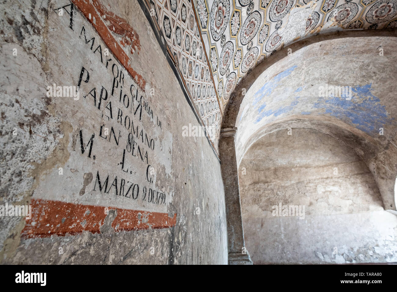 Painted murals on a wall in the San Nicolas Tolentino Temple and Ex-Monastery in Actopan, Hidalgo, Mexico. The colonial church and convent  was built in 1546 and combine architectural elements from the romantic, gothic and renaissance periods. - Stock Image