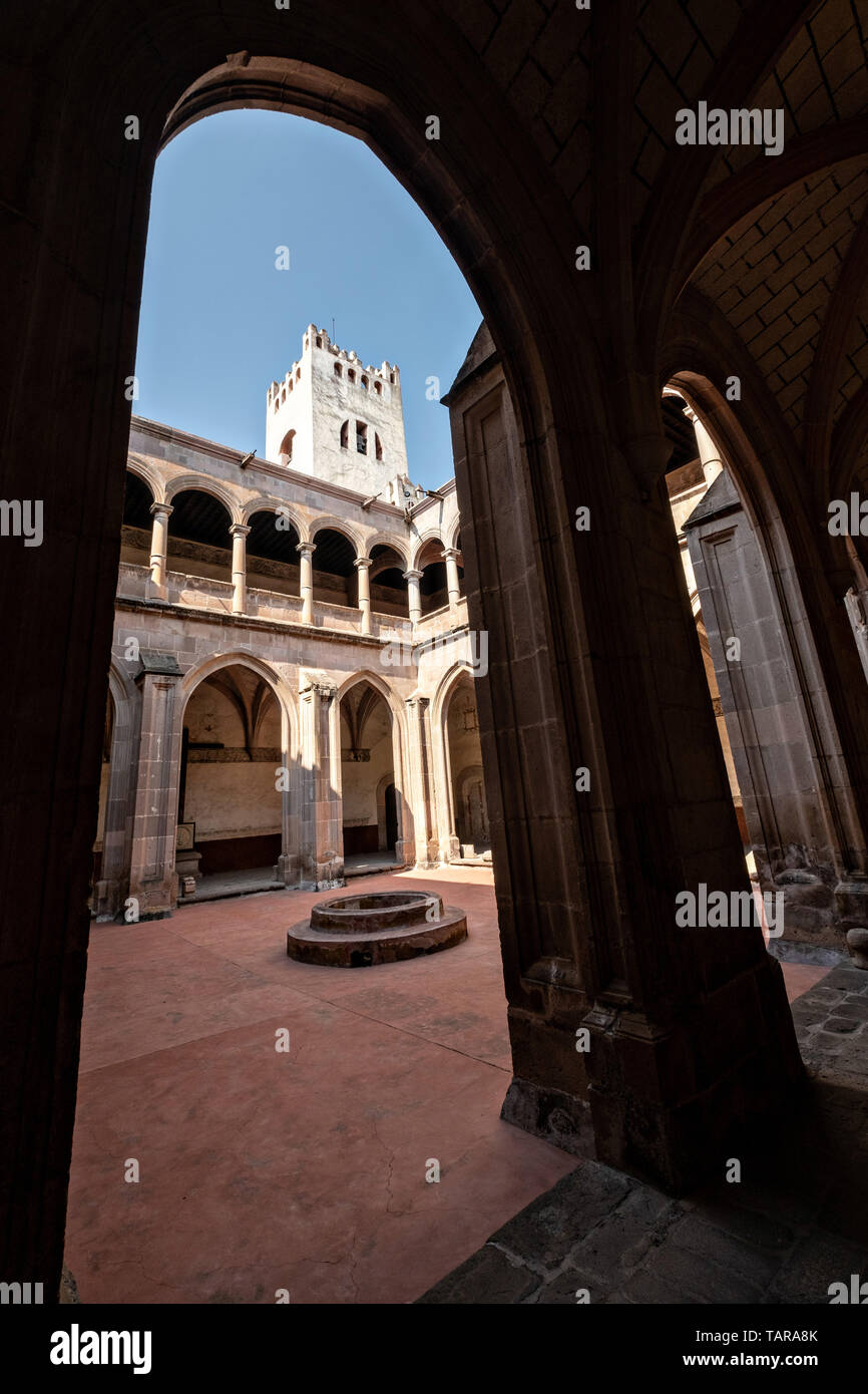 View of the central convent courtyard at the San Nicolas Tolentino Temple and Ex-Monastery in Actopan, Hidalgo, Mexico. The colonial church and convent  was built in 1546 and combine architectural elements from the romantic, gothic and renaissance periods. Stock Photo