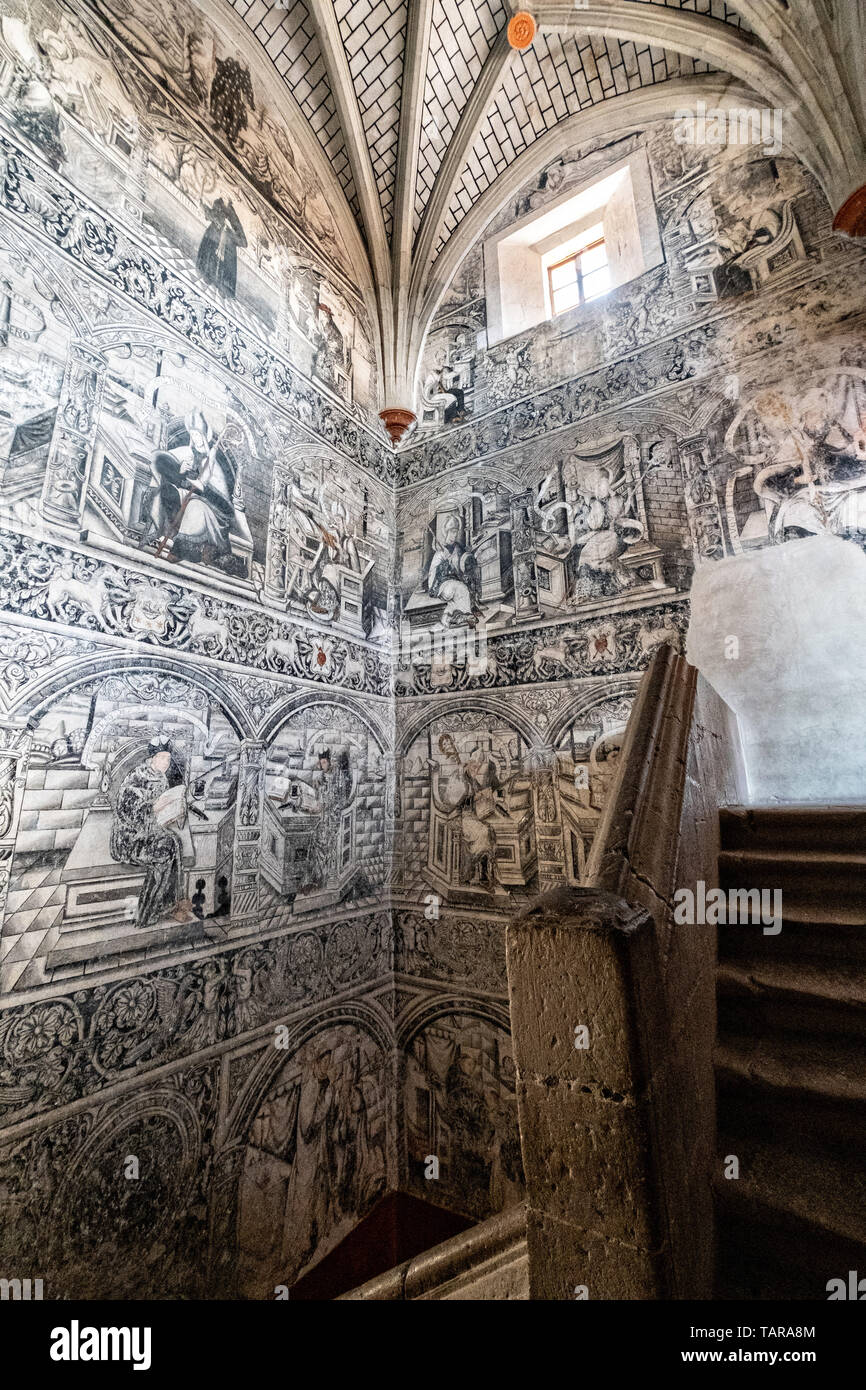 Black & white painted stairway murals in the San Nicolas Tolentino Temple and Ex-Monastery in Actopan, Hidalgo, Mexico. The colonial church and convent  was built in 1546 and combine architectural elements from the romantic, gothic and renaissance periods. - Stock Image