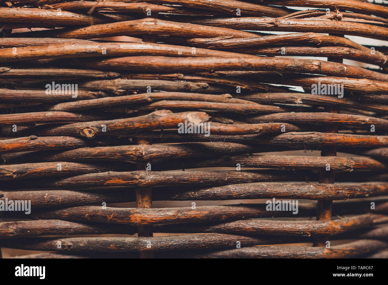 Organic woven willow wicker fence panel suitable for crafts, picnic or gardening background. 2019 - Stock Image