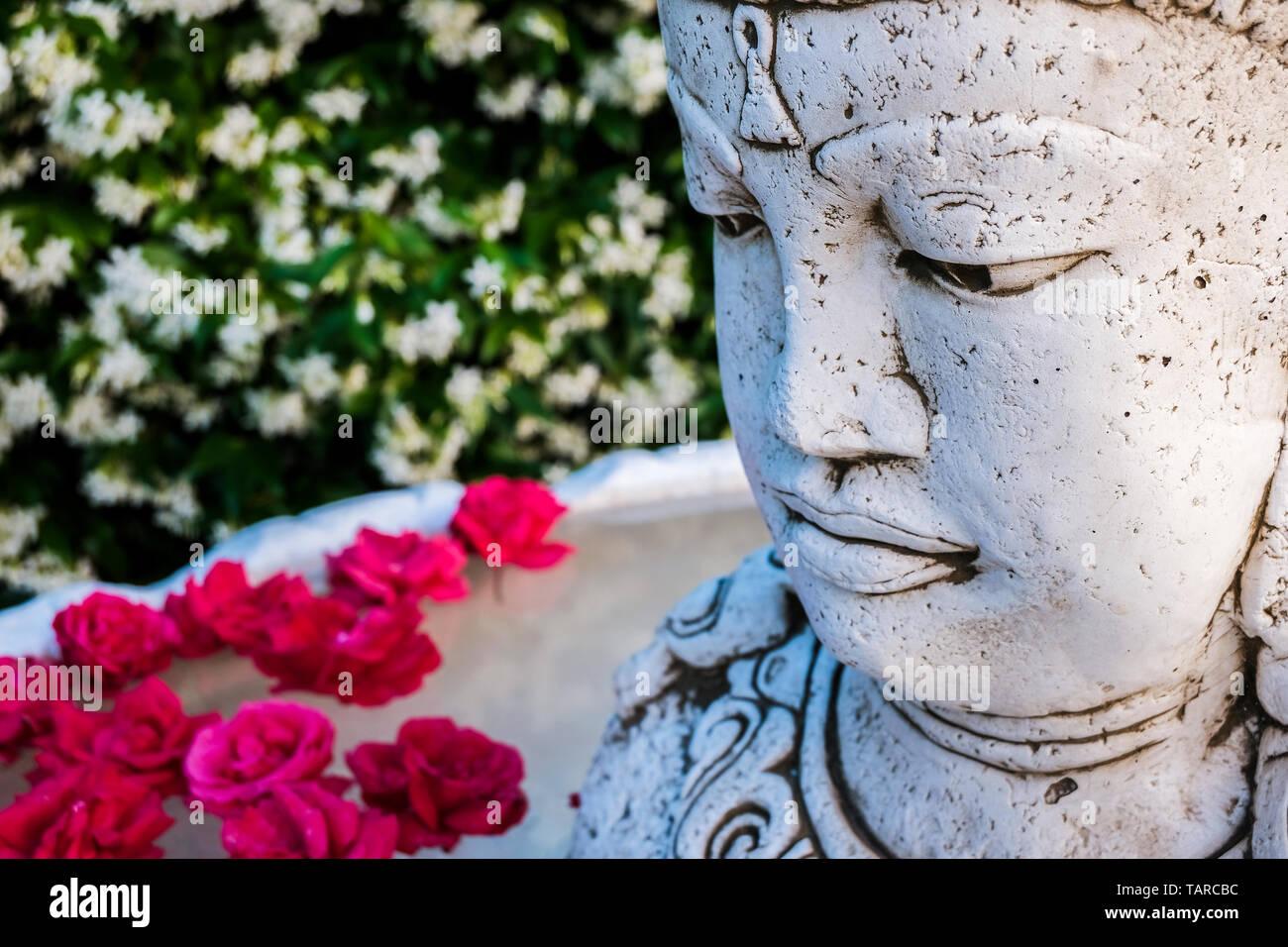 Brahma statue in a garden. - Stock Image