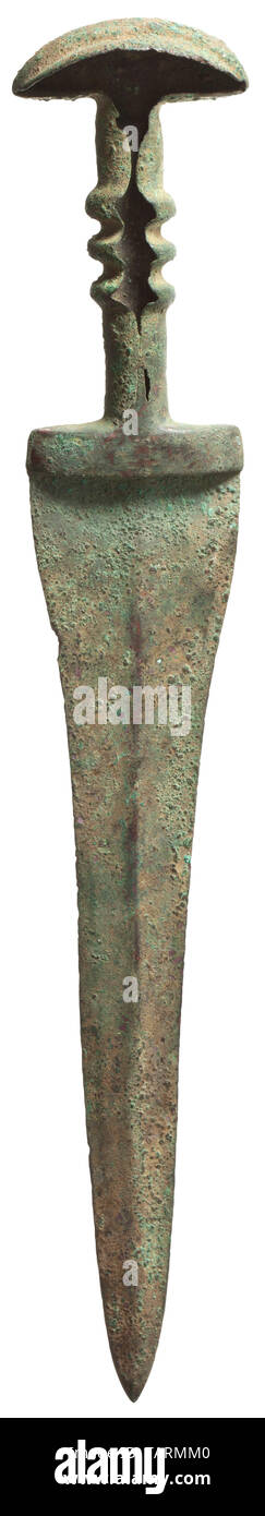 A Northern Iranian bronze dagger, the hilt recessed for inlay, 13th - 10th century BC, Dagger probably made of two pieces, cast-on handle extending to the shoulder of the blade. The edges of the blade waisted and tapering toward the point. Flat, slightly domed central ridge. The handle with three central ribs. The lower part of the grip is fully embraced by the cornice while the ribbed central section and pommel are open, leaving a cavity for the now missing inlays. The pommel slightly bent at top and featuring a wide central bulge. Fine green pa, Additional-Rights-Clearance-Info-Not-Available - Stock Image