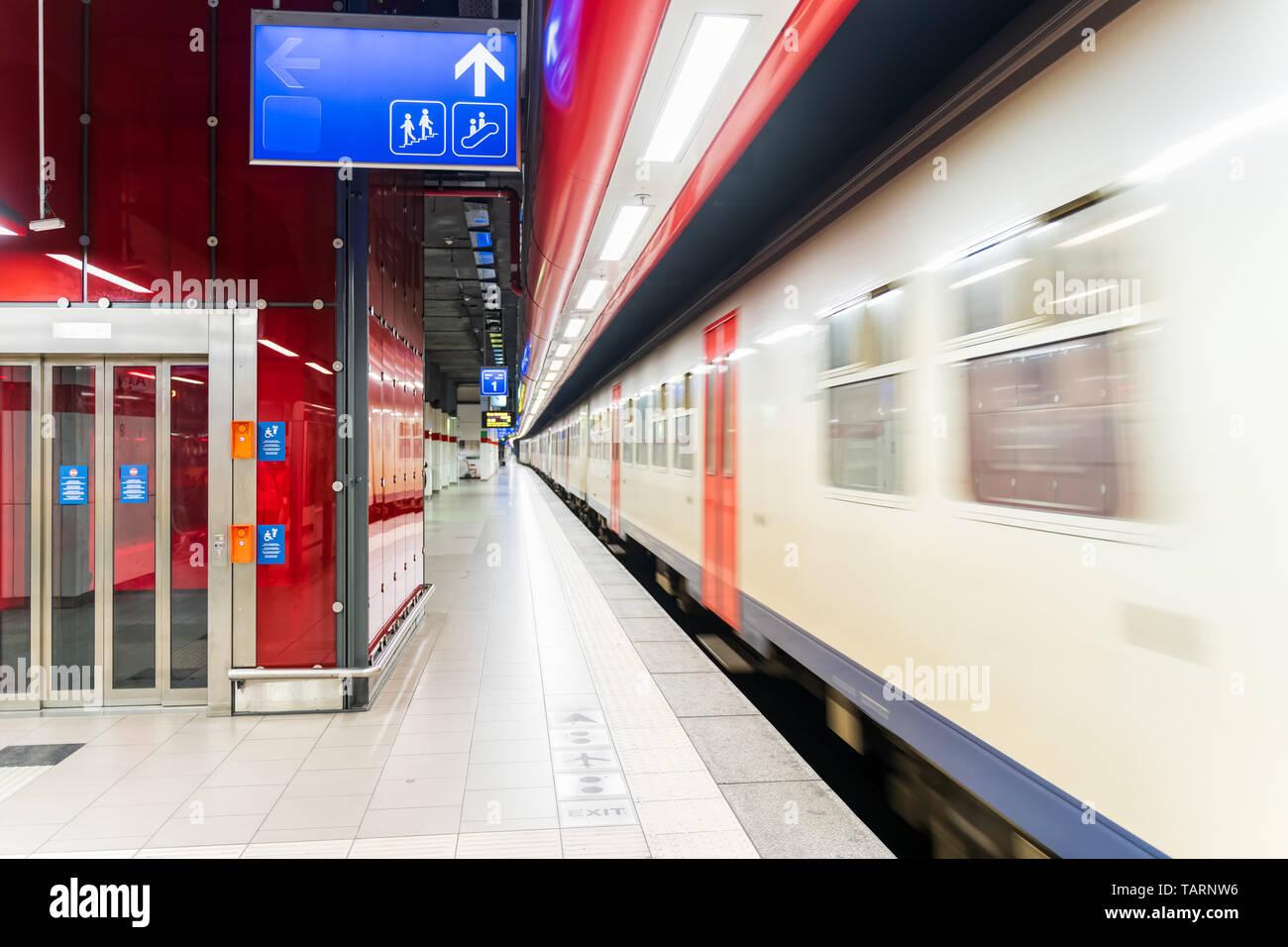 Empty subway station with speeding train, motion blur, Brussels Belgium - Stock Image