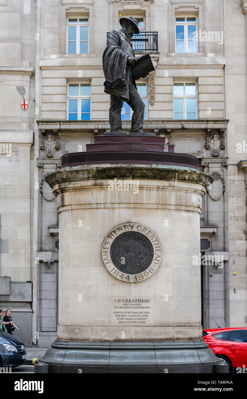 A statue of South African civil engineer James Henry Greathead designed by James Butler stand in Cornhill at Royal Exchange in London, UK - Stock Image