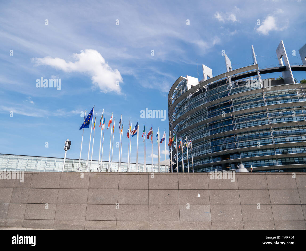 Strasbourg, France - May 26, 2019: European Parliament headquarter with all European Union flags waving - clear blue sky in background - Stock Image