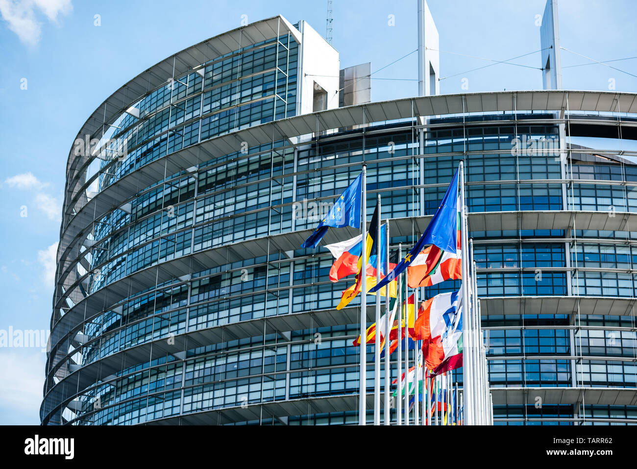 Flags of European Union and member states waving in calm wind in front of the Parliament headquarter on the day of 2019 European Parliament election - Stock Image