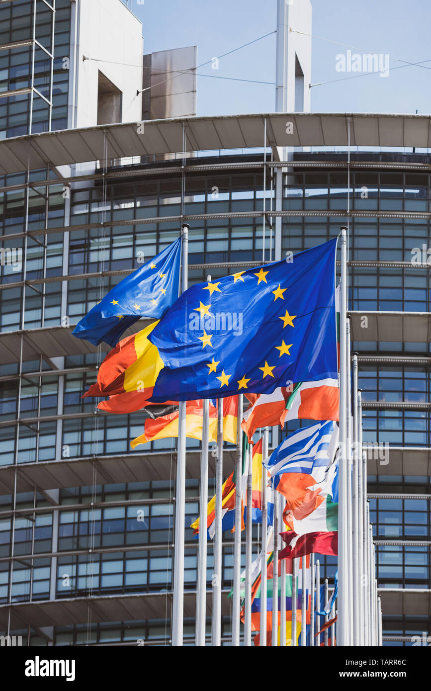 Flags of all states members of European Union waving in calm wind in front of the Parliament headquarter on the day of 2019 European Parliament election - Stock Image