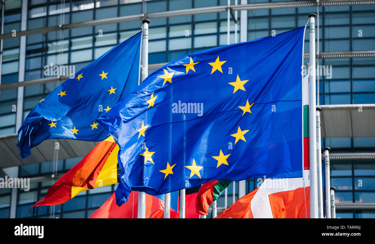 Flags of all member states of the European Union waving in calm wind in front of the Parliament headquarter on the day of 2019 European Parliament election. - Stock Image
