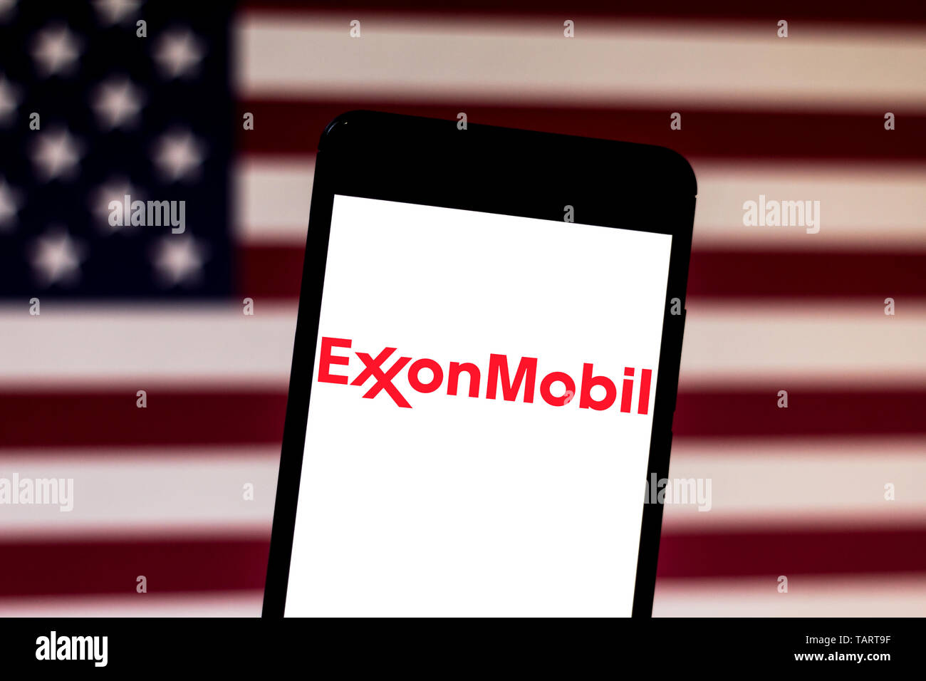 In this photo illustration the Exxon Mobil Corporation logo is seen displayed on a smartphone. - Stock Image