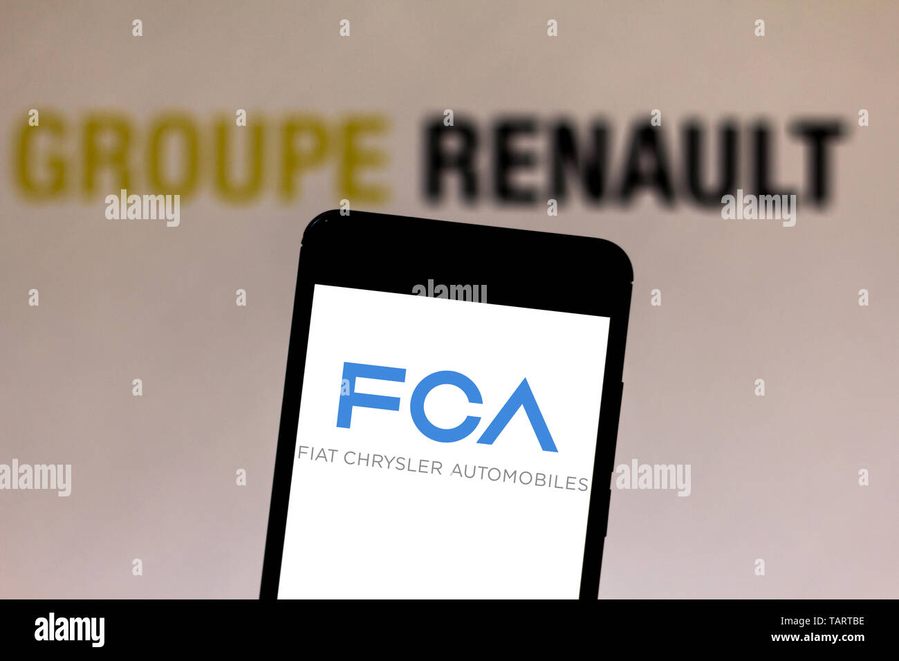 In this photo illustration the Fiat Chrysler Automobiles logo is seen displayed on a smartphone. Stock Photo