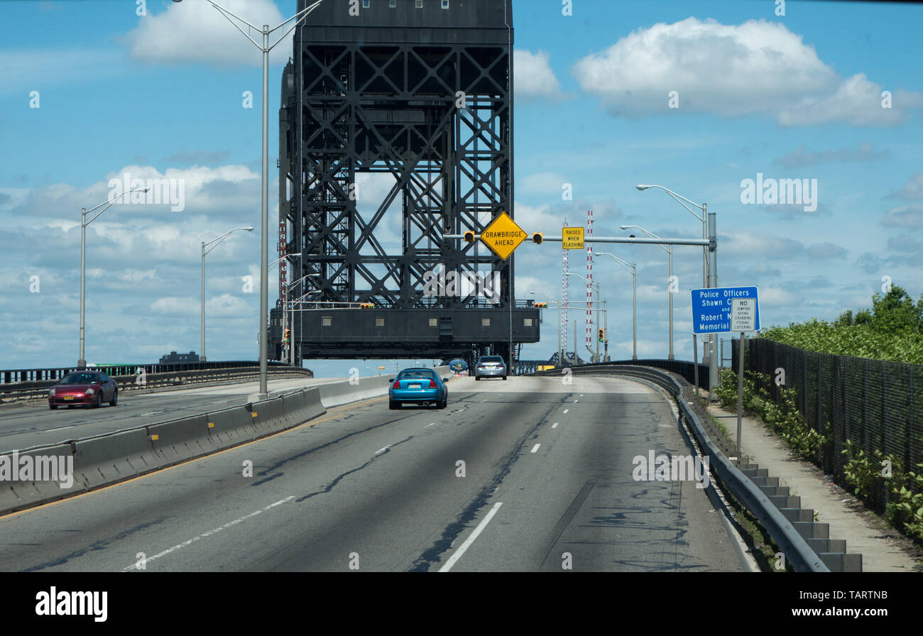 The Lincoln Highway Hackensack River Bridge is a vehicular vertical lift bridge crossing the Hackensack River in New Jersey, USA - Stock Image
