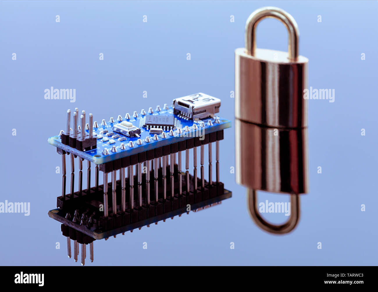 The lock near the computer chip is data encryption, the concept of coding technology of operational information and the protection of personal data. - Stock Image