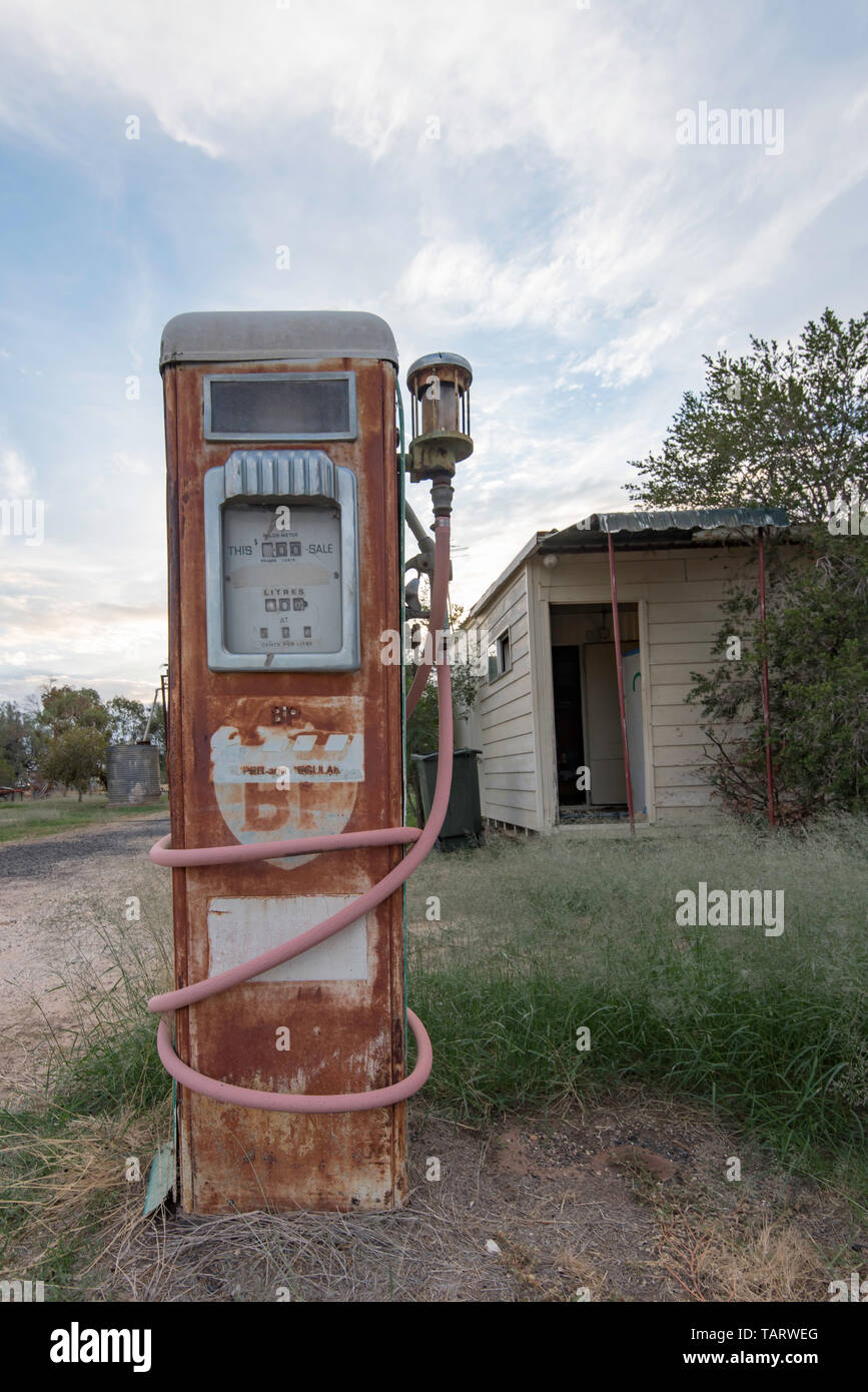 An old petrol (gas) bowser (pump) beside the road in the New