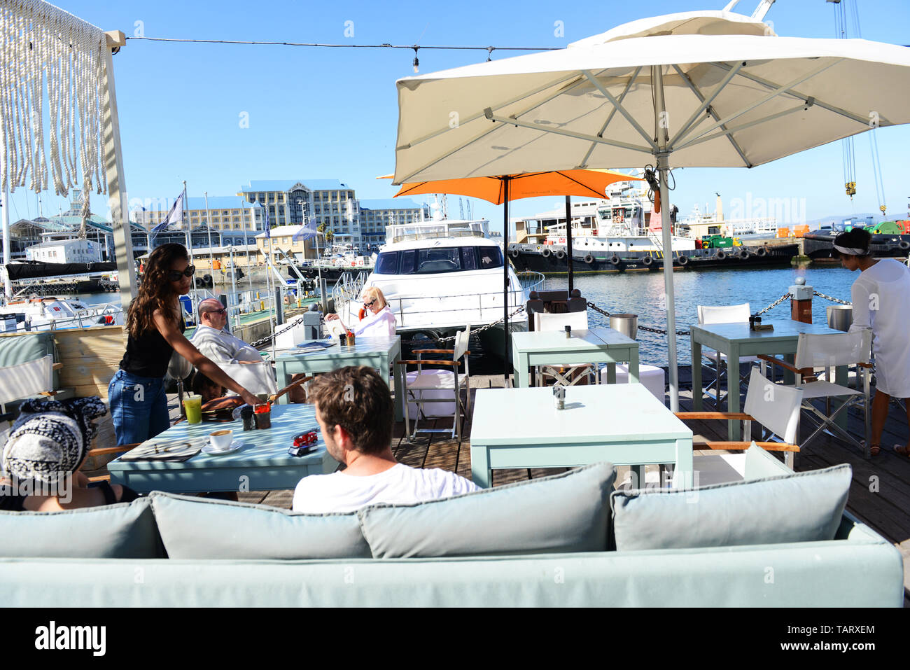 vibrant restaurants and cafes at the V&A water front area in Cape Town, South Africa. - Stock Image