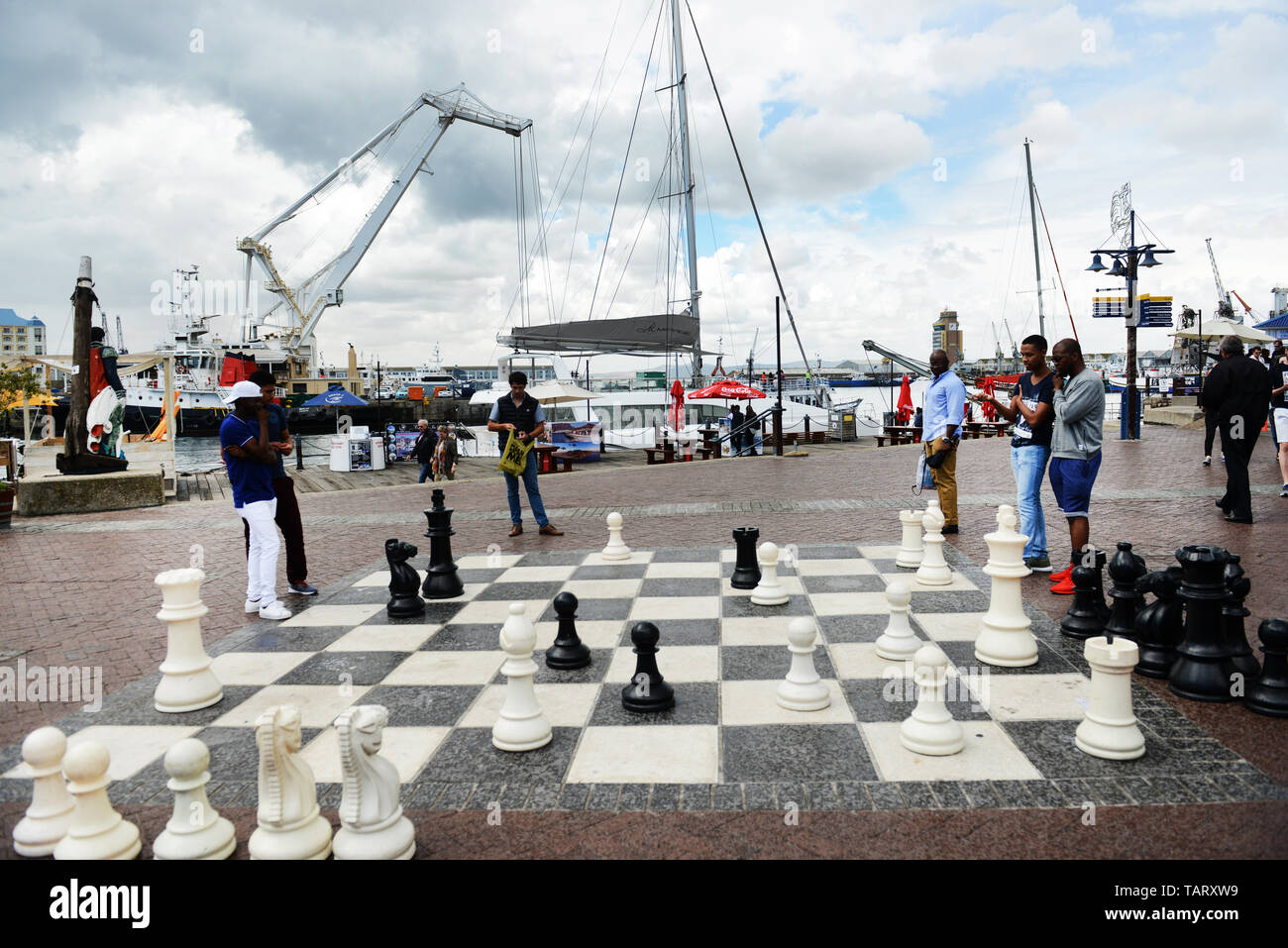 A 'Giant' chess game at the vibrant V&A water front area in Cape Town, South Africa. - Stock Image