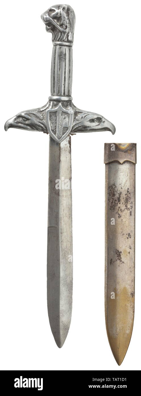 """An honour dagger presented to war invalids - """"Pugnale d'Onore per Mutilati e Invalidi"""", Nickel-plated blade of diamond section, one half double-edged towards the point. The aluminium handle forged in one piece, the quillons terminating into eagle-head finials and bearing the shield with fasces and/or the war invalids' badge. The grip ribbed lengthwise with a lion's head pommel. Silver-plated (rubbed) brass scabbard with suspension bar on the back. Length circa 33 cm. Extremely rare weapon of honour, seldom awarded. Italian, Europe, European, hist, Additional-Rights-Clearance-Info-Not-Available Stock Photo"""