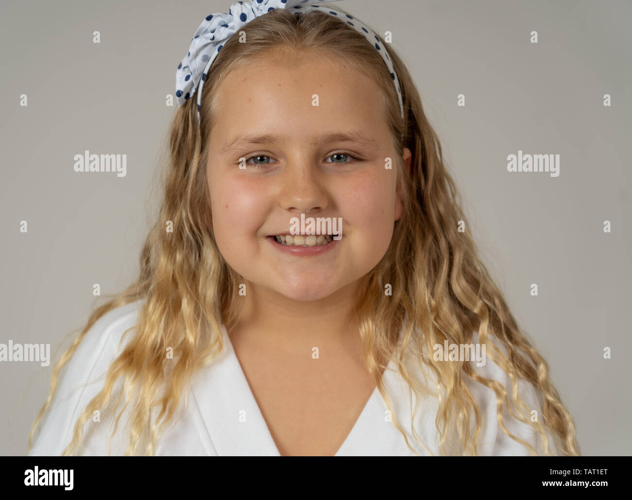 Cute charming happy excited and cheerful young kid modeling and posing with great confidence and self esteem. Close up Beauty portrait in Positive hum - Stock Image