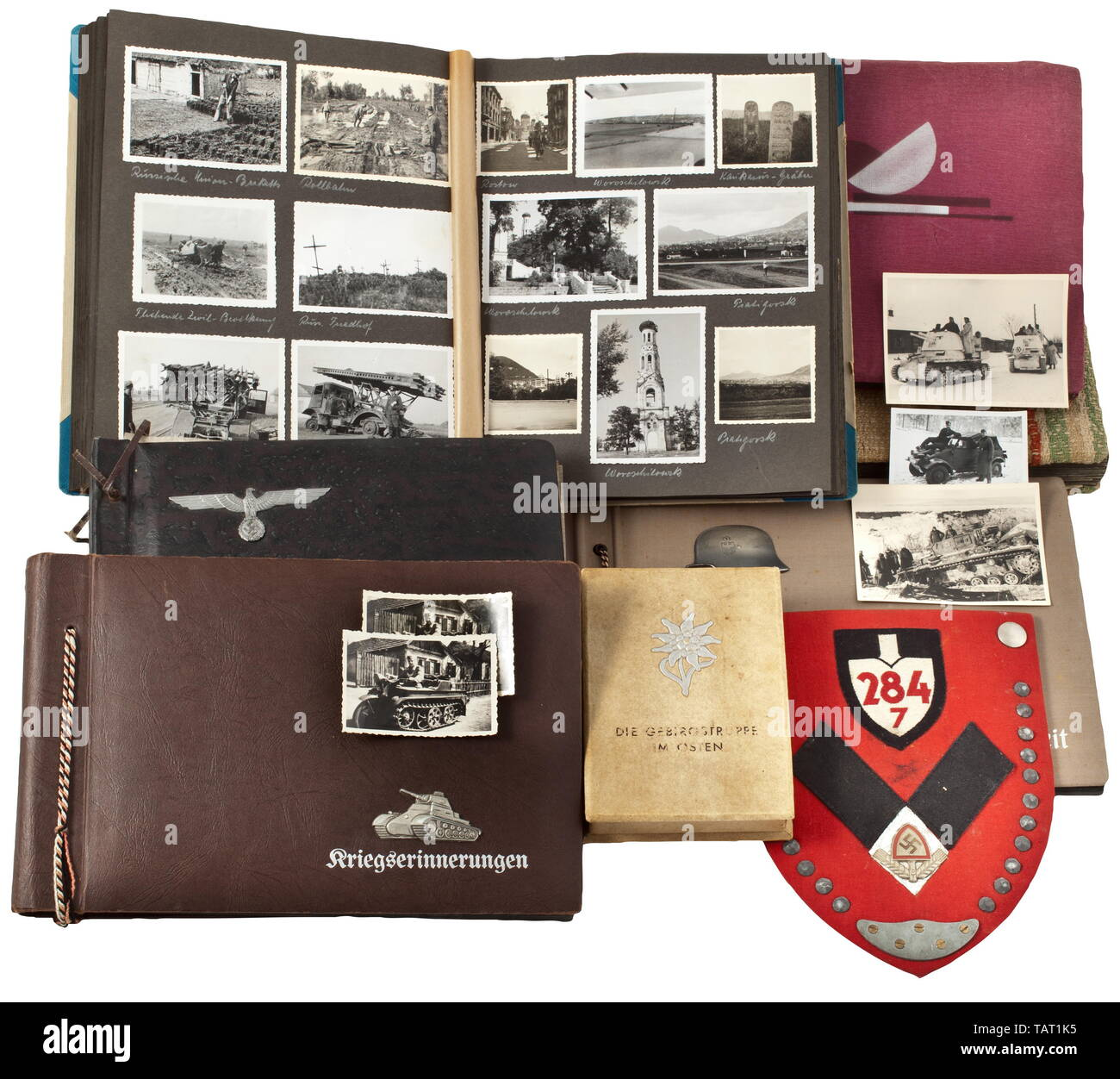 A large grouping of private military photographs - Wehrmacht in many theatres of war, More than 1,000 photos in six albums (some captioned), some also loosely enclosed. The pictures depicting training, award ceremonies, many technical features such as tanks, aircraft, guns, and other military gear. Prisoners of war, trenches and positions, destroyed towns and combat scenes (predominantly in France and Russia). Also a picture set (tr.) 'The Mountain Troops in the East' and RAD photo album with commemorative shovel made of cloth. Due to the large number of photos a pre-sale v, Editorial-Use-Only - Stock Image