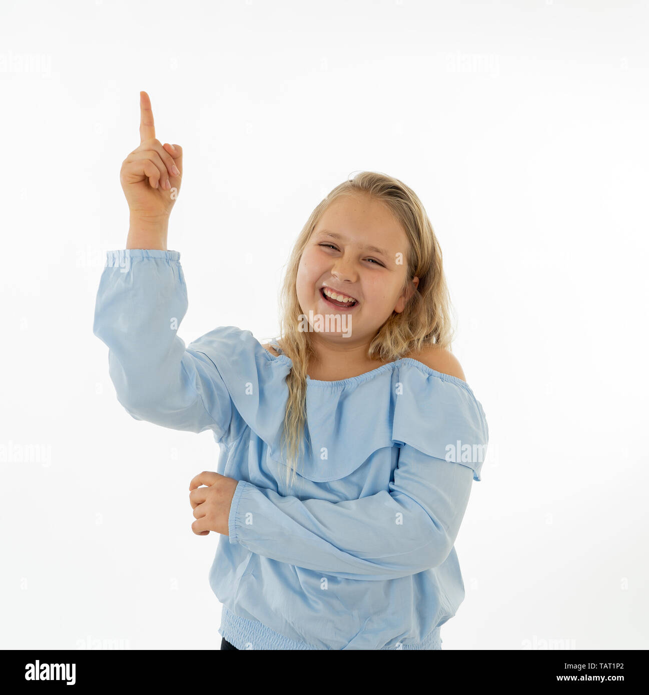 Cute excited, funny, cheerful young kid happy face finger pointing out at copy space. Positive human emotions, body language and expressions. Close up - Stock Image