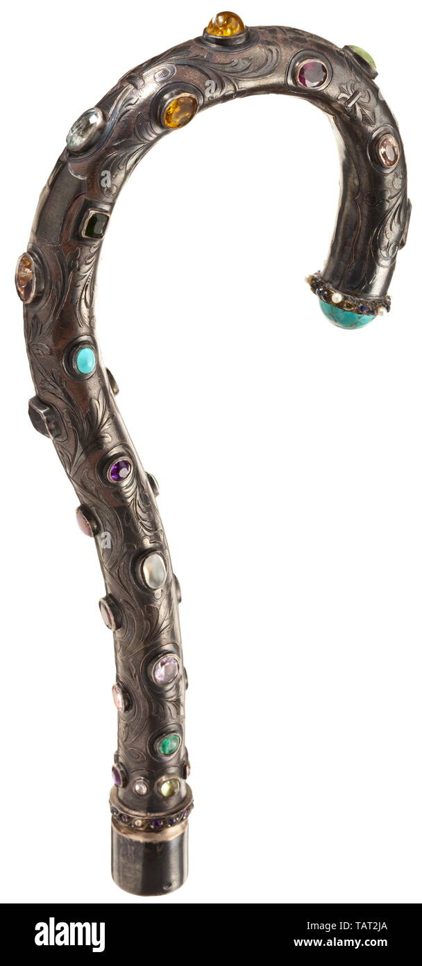 "Sandoz, Gustave (1836 - 1891) - a walking stick handle set with gems, Silver grip with raised, etched floral tendrils, the entire surface decorated with set gems and pearls, silversmith's mark, on the inside engraved signature ""Gustave Sandoz Paris"". Length 22.5 cm. Weight 163 g. Gustave Sandoz, French watchmaker and jeweller, was born in Paris on 11 September 1836. His father was a watchmaker of Swiss descent from the area of Neuchatel. At the age of 13 Jacques-Gustave began his apprenticeship with the then well-known watchmaker Perusset. In 185, Additional-Rights-Clearance-Info-Not-Available Stock Photo"