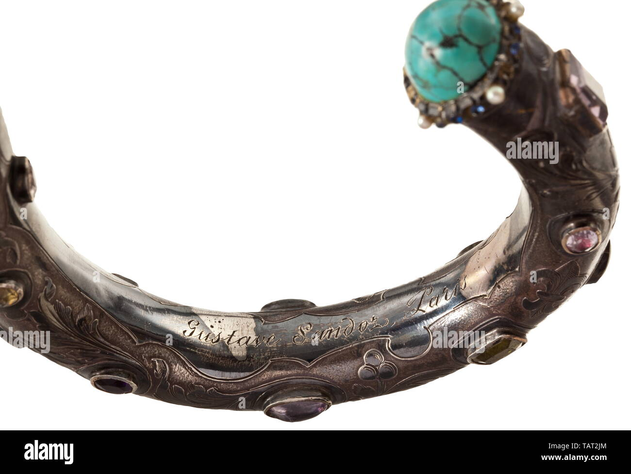 """Sandoz, Gustave (1836 - 1891) - a walking stick handle set with gems, Silver grip with raised, etched floral tendrils, the entire surface decorated with set gems and pearls, silversmith's mark, on the inside engraved signature """"Gustave Sandoz Paris"""". Length 22.5 cm. Weight 163 g. Gustave Sandoz, French watchmaker and jeweller, was born in Paris on 11 September 1836. His father was a watchmaker of Swiss descent from the area of Neuchatel. At the age of 13 Jacques-Gustave began his apprenticeship with the then well-known watchmaker Perusset. In 185, Additional-Rights-Clearance-Info-Not-Available Stock Photo"""