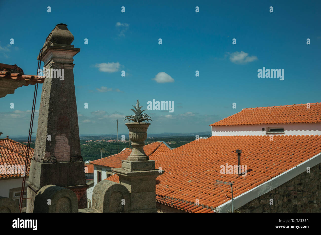 Roofs of houses and chimney with countryside landscape in a sunny day at Seia. A nice village of Portugal also known for its delicious cheese. - Stock Image