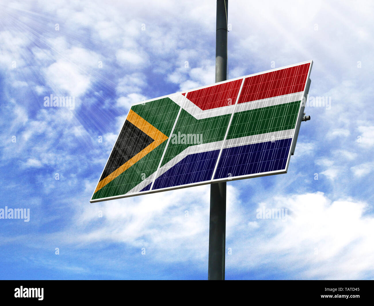 Solar panels against a blue sky with a picture of the flag of South Africa - Stock Image
