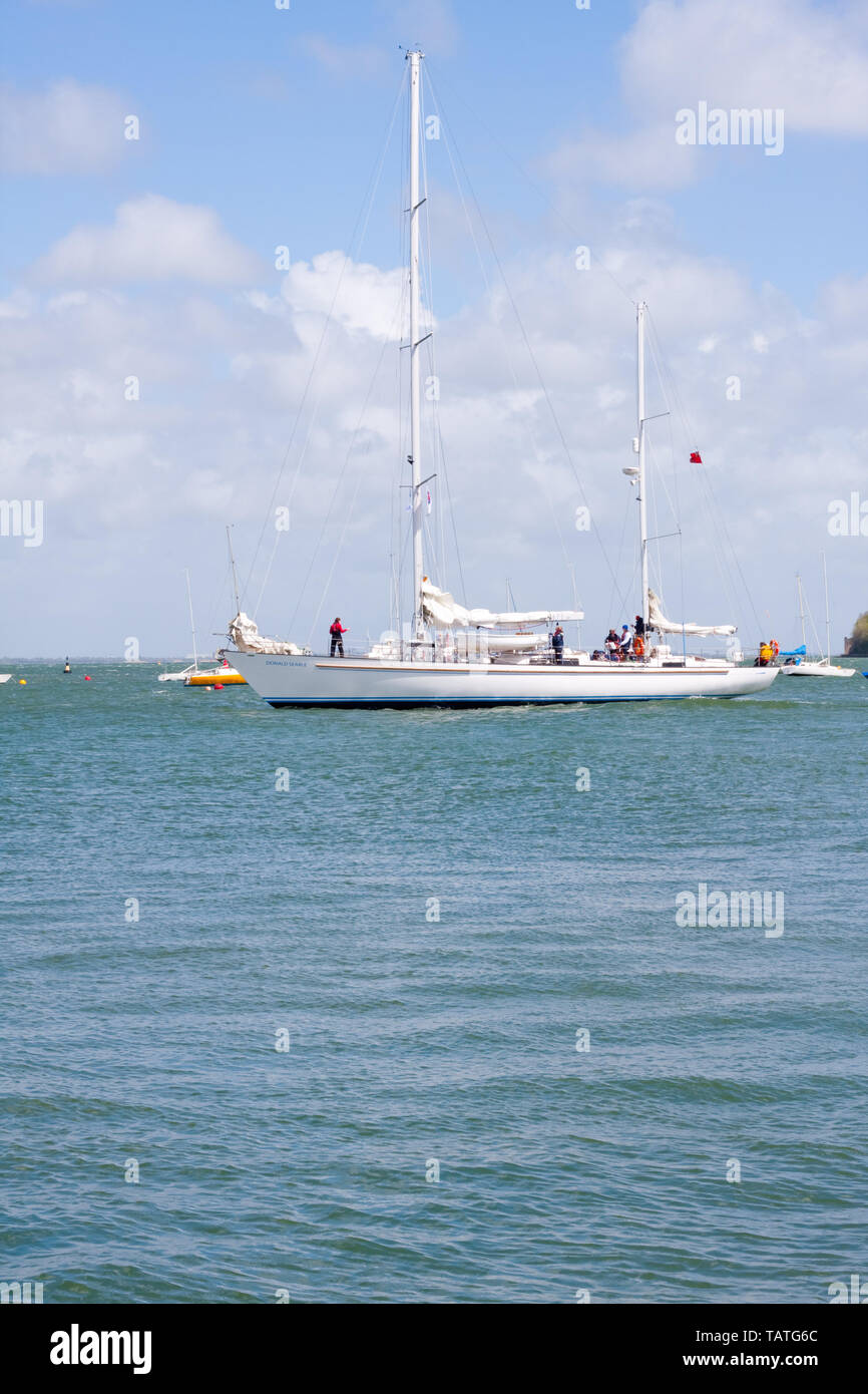 The yacht Donald Searle, a Bermudan ketch, which is used by the Rona sailing project, leaving Cowes harbour on the Isle of Wight - Stock Image