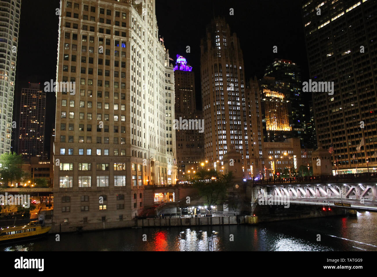 The Wrigley Building, Tribune Tower, and 401 N Michigan Ave along the Chicago River in downtown Chicago, Illinois at night Stock Photo