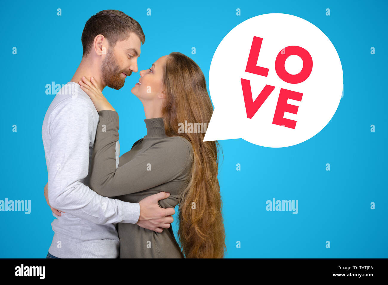 happy young couple looking at each other - Stock Image