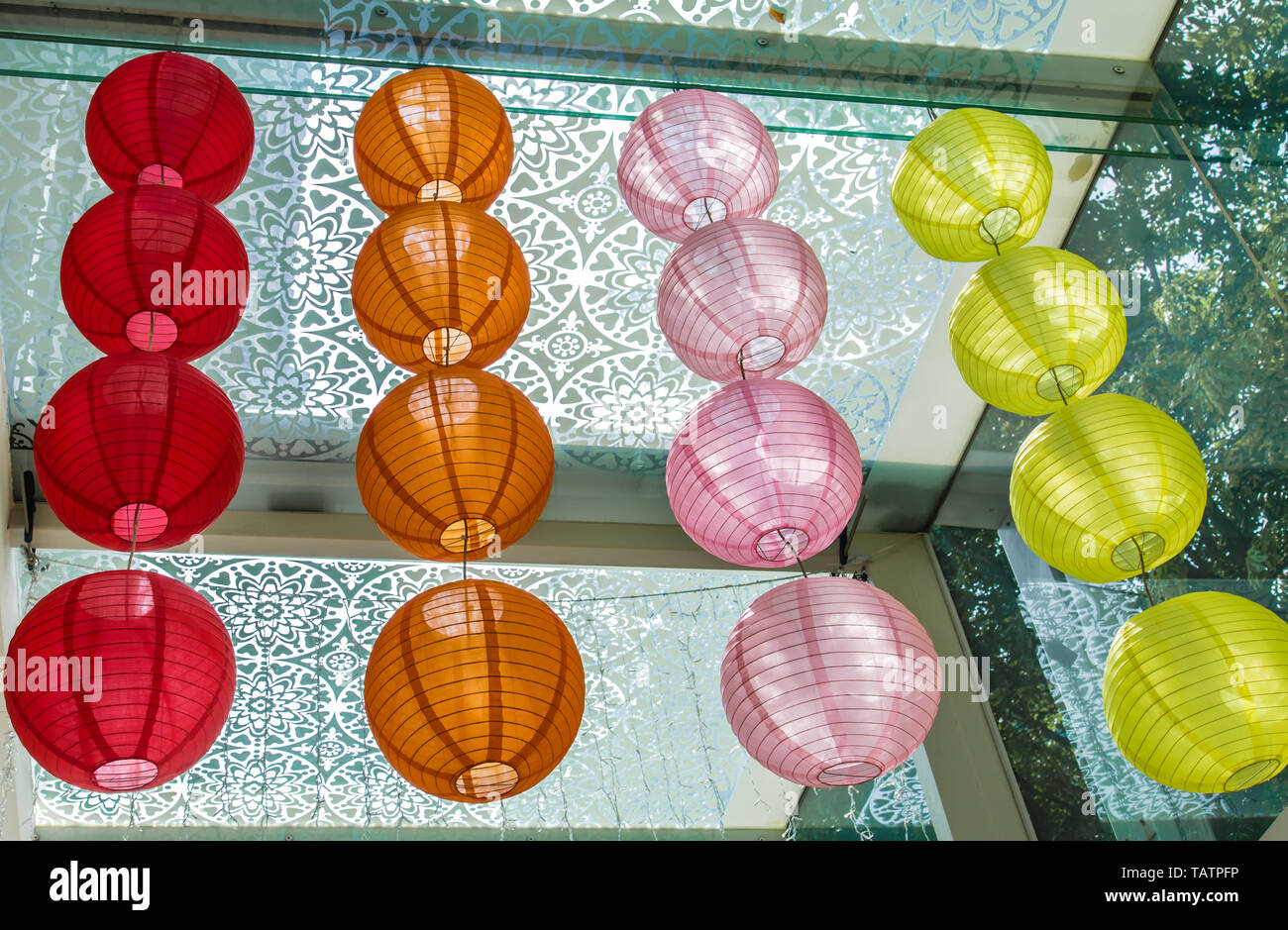 colorful japan style lantern hang on the glass Ceiling - Stock Image