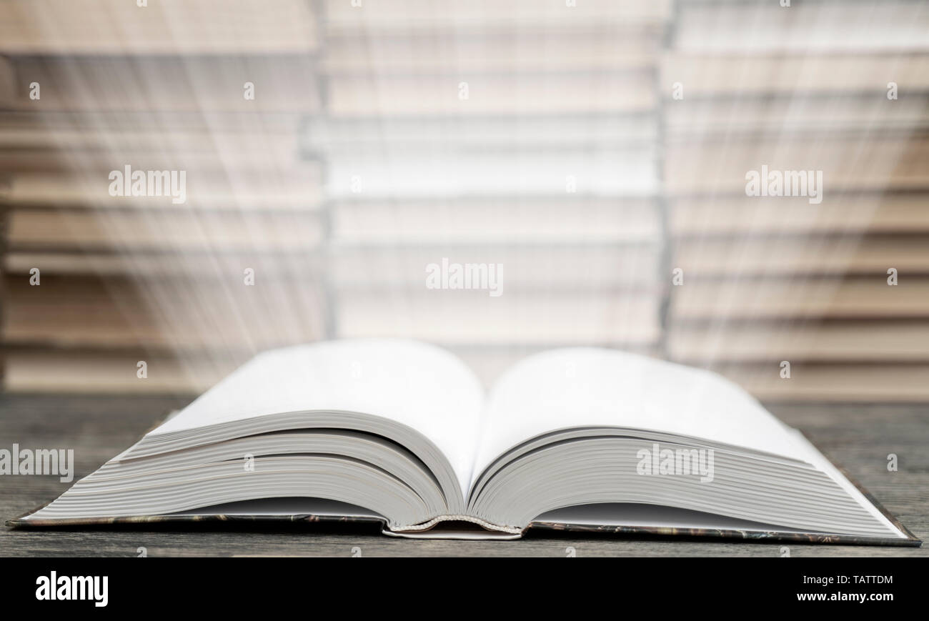 Book pages emit light. Symbol of wisdom, knowledge and learning. Stock Photo