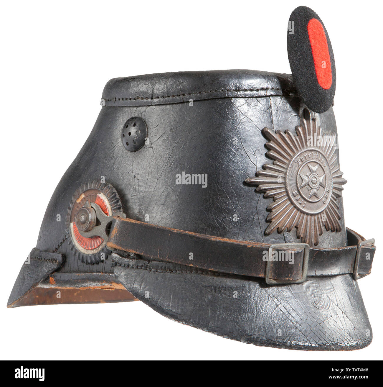 IMPERIAL GERMANY UNTIL 1914, An imperial German Württemberg mountain troops enlisted men's shako Black leather body, front and back visors have some crazing, front plate of Württemberg order attached by loops with leather inserts, red and black field badge (new), rusty national colours cockade, black leather chinstrap with grey buckles and M 91 lug side posts, tan leather liner (worn), very rare unit. CNN377, Additional-Rights-Clearance-Info-Not-Available - Stock Image