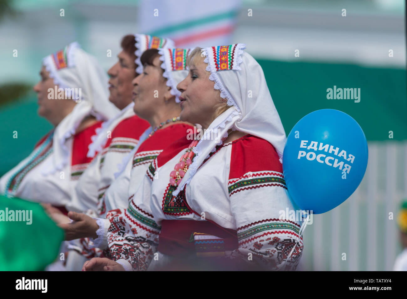 RUSSIA, Nikolskoe village, Republic of Tatarstan 25-05-2019: A group of mature women dancing traditional dance. A balloon with a name of Political Par Stock Photo