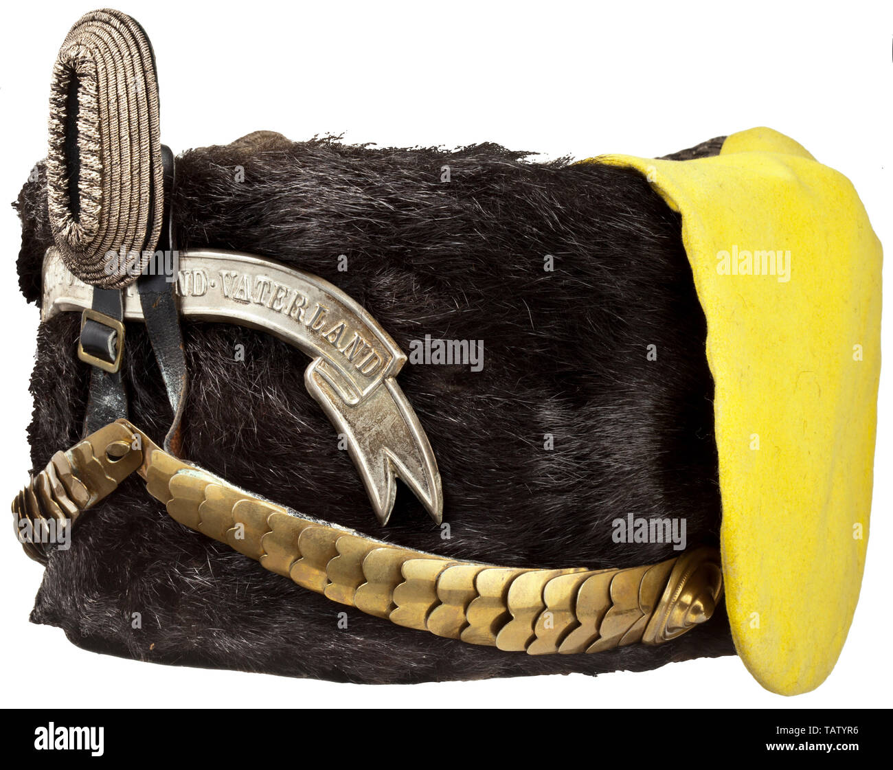 A fur cap, circa 1900, for officers of the Hussar Regiment Kaiser Franz Joseph von Österreich (Schleswig-Holstein) no. 16, Cover of dark brown otter fur, rounded brass chinscales, officer's cockade, silver patriotic banner, lemon-yellow bag, field insignia made of silver and velvet, lanyard of silver cord of rectangular section with slide and toggle. Light coloured silk lining (damaged) with wearer's name, light brown leather sweatband. The central leather section of the chinscales (circa 9 cm) a matching replacement. Slightly damaged, traces of , Additional-Rights-Clearance-Info-Not-Available - Stock Image