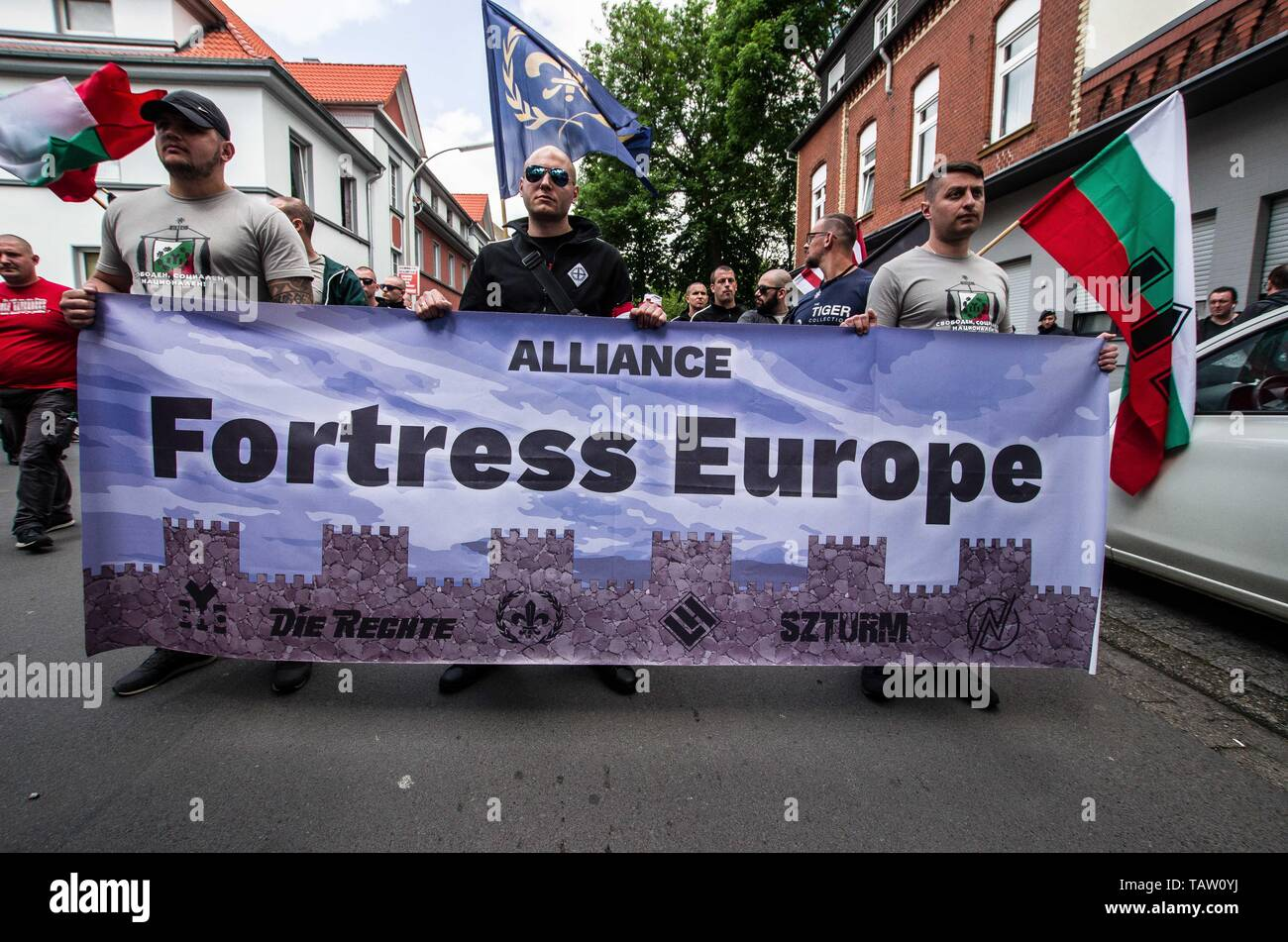 Dortmund, Nordrhein Westfalen, Germany. 25th May, 2019. The Alliance Fortress Europe banner being held by Bulgarian, French, German, and Hungarian neonazis in Dortmund, Germany. Prior to the European Elections, the neonazi party Die Rechte (The Right) organized a rally in the German city of Dortmund to promote their candidate, the incarcerated Holocaust denier Ursula Haverbeck. The demonstration and march were organized by prominent local political figure and neonazi activist Michael Brueck (Michael Brück) who enlisted the help of not only German neonazis, but also assistance from Russian, Stock Photo